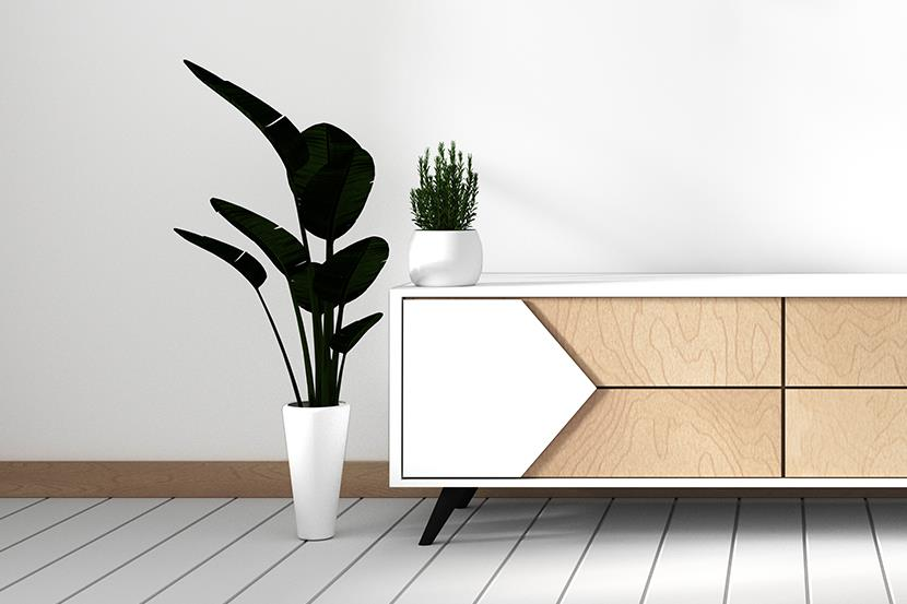 modern white laminate tv cabinet with plants on either side