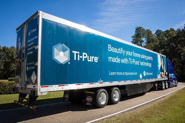 blue tipure truck on green road