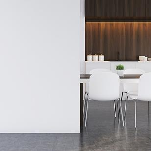 brown and white table and white chairs against white wall in brown modern kitchen
