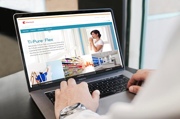 hands on a laptop with ti-pure flex content