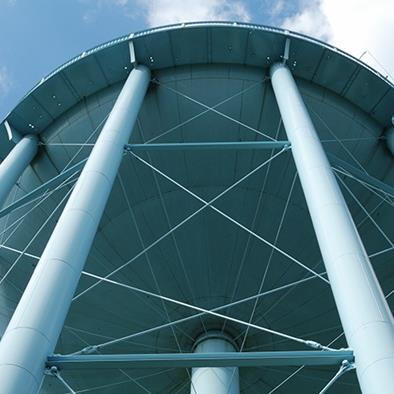 looking up at the bottom of a white water tower